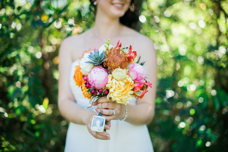 Portrait of the Bride holding her wedding flowers bouquet.