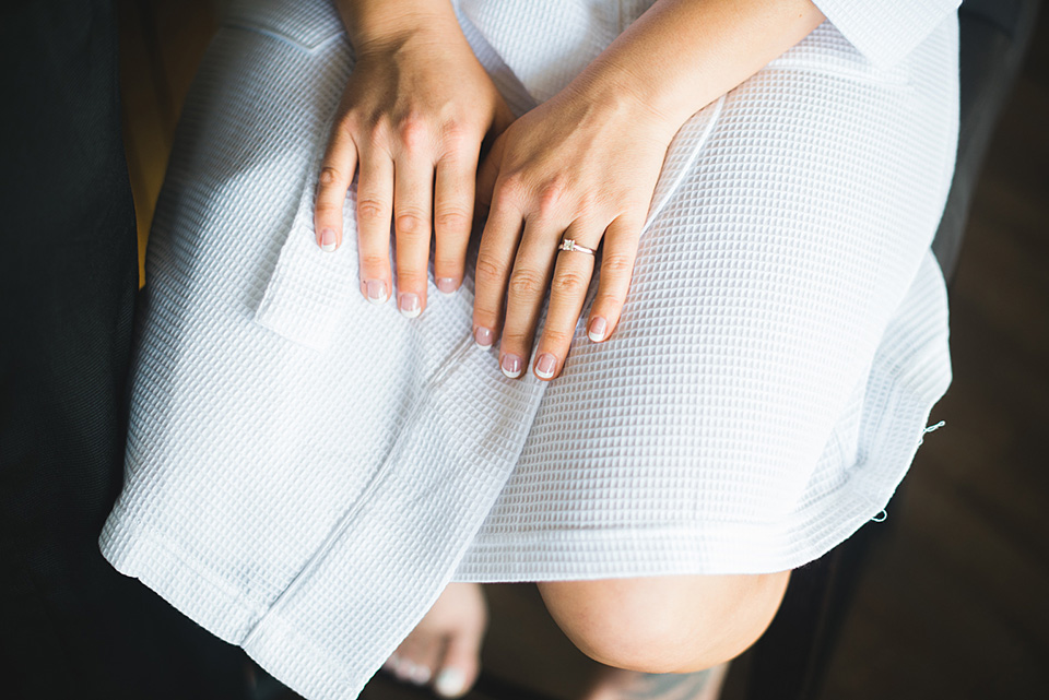 Close up of Bride's ring with her hands on her lap.