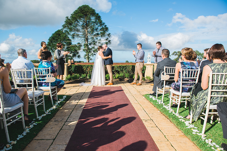 Wedding ceremony for Georgie and Jamie at Flaxton Gardens