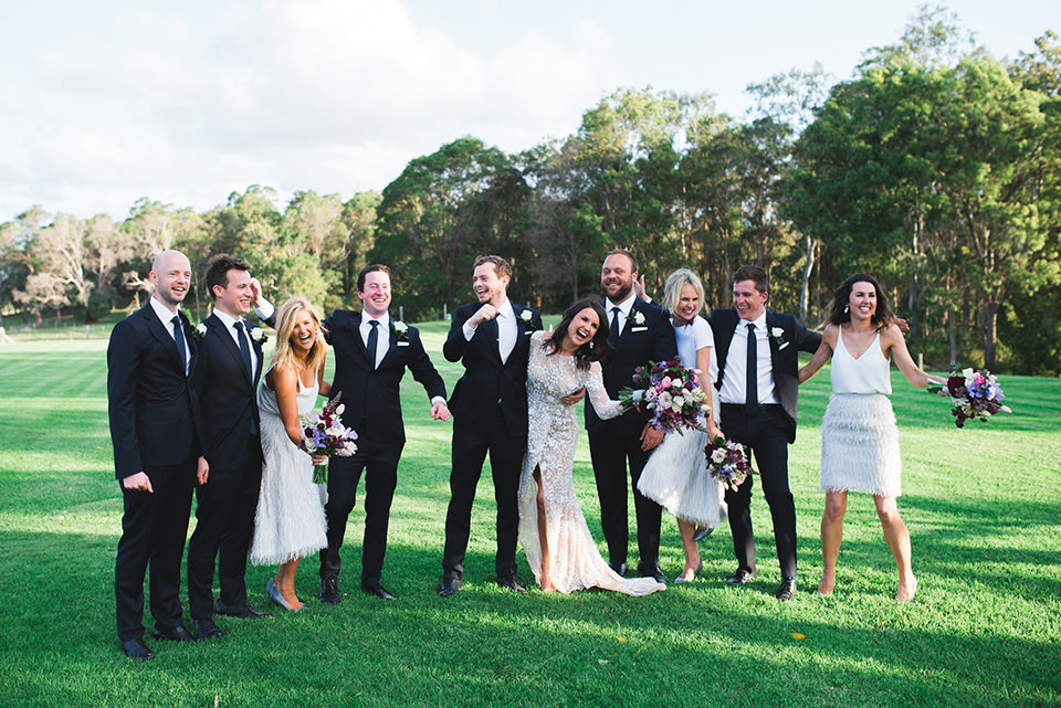 Photo of the bridal party celebrating after the ceremony.