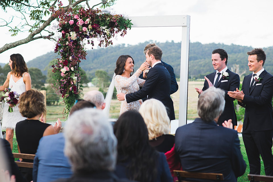 First kiss at the farm wedding ceremony