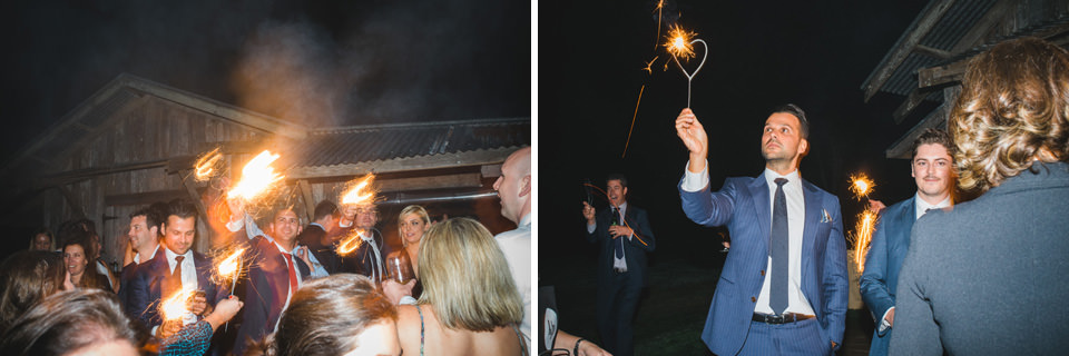 a sparkler exit at the wedding, in front of the barn