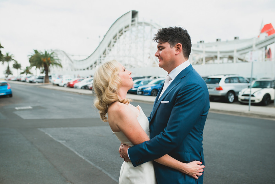 Anthea & James' wedding photos outside Luna Park in St Kilda, Victoria.