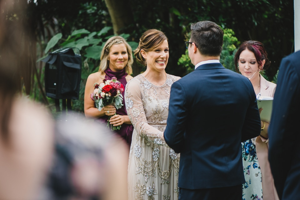The bride laughing during her Victoria Gardens prahran wedding ceremony.