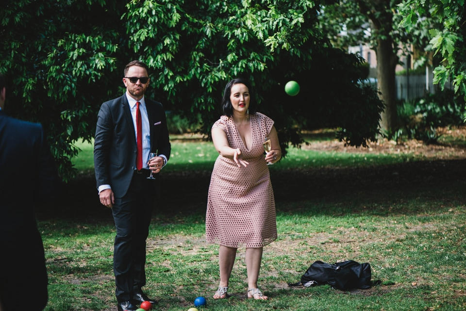 Wedding guests playing lawn games and boche.