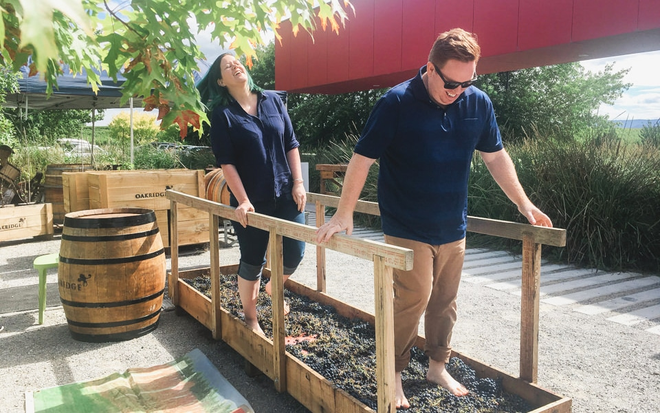Glen and Fiona from Lionheart Photography, stomping on grapes at Oakridge Winery.