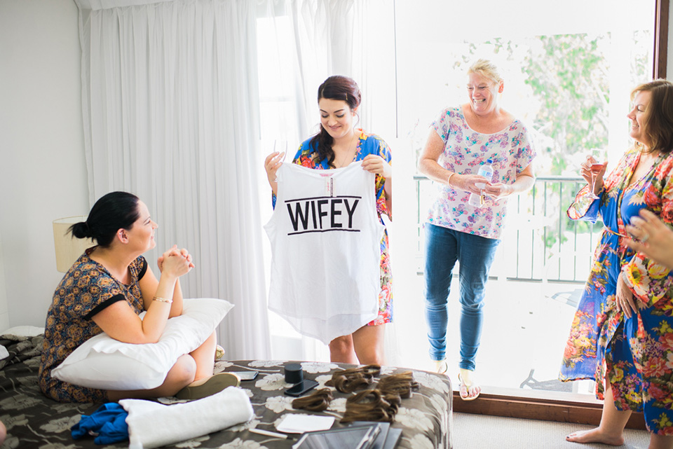 Bride holding a wifie shirt