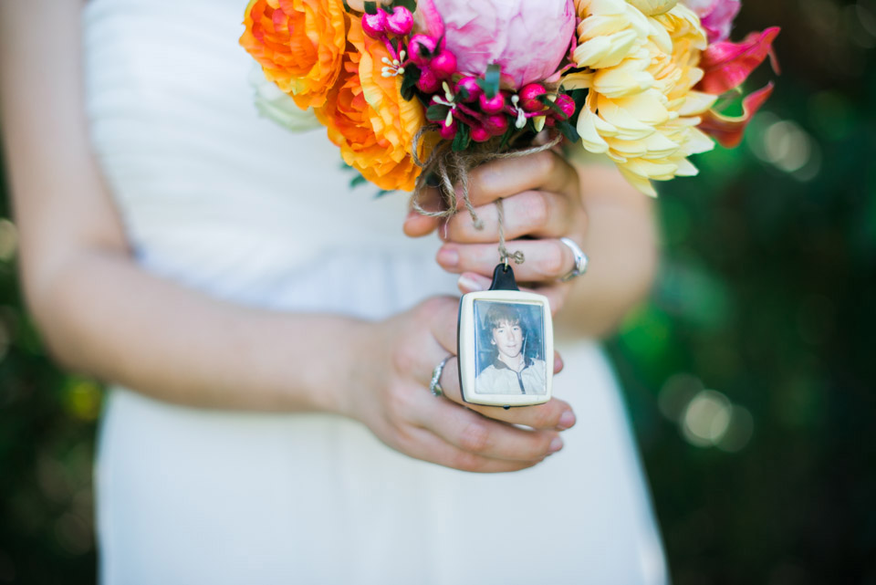 The brides bouquet has a photo of her father attached.
