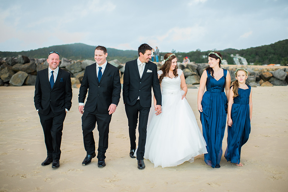 photo of the bridal party on Noosa main beach by wedding photographers, Lionheart Photography.