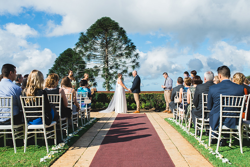 Wedding ceremony for Georgie and Jamie at Flaxton Gardens, by Maleny Wedding Photographer Lionheart Photography.