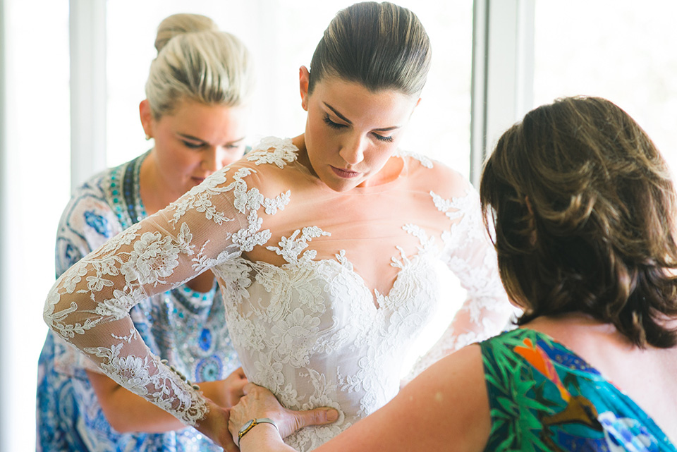 The bride putting on her Steven Khalil wedding dress in Melbourne