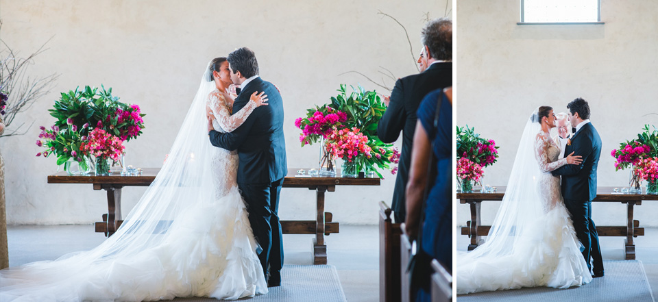 First kiss, at their wedding ceremony in the chapel at Stones of the Yarra Valley in Melbourne