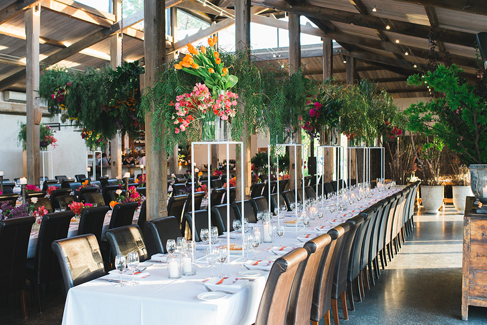 Photo of tables and chairs with an amazing wedding floral styling by The Flower Jar in Melbourne.