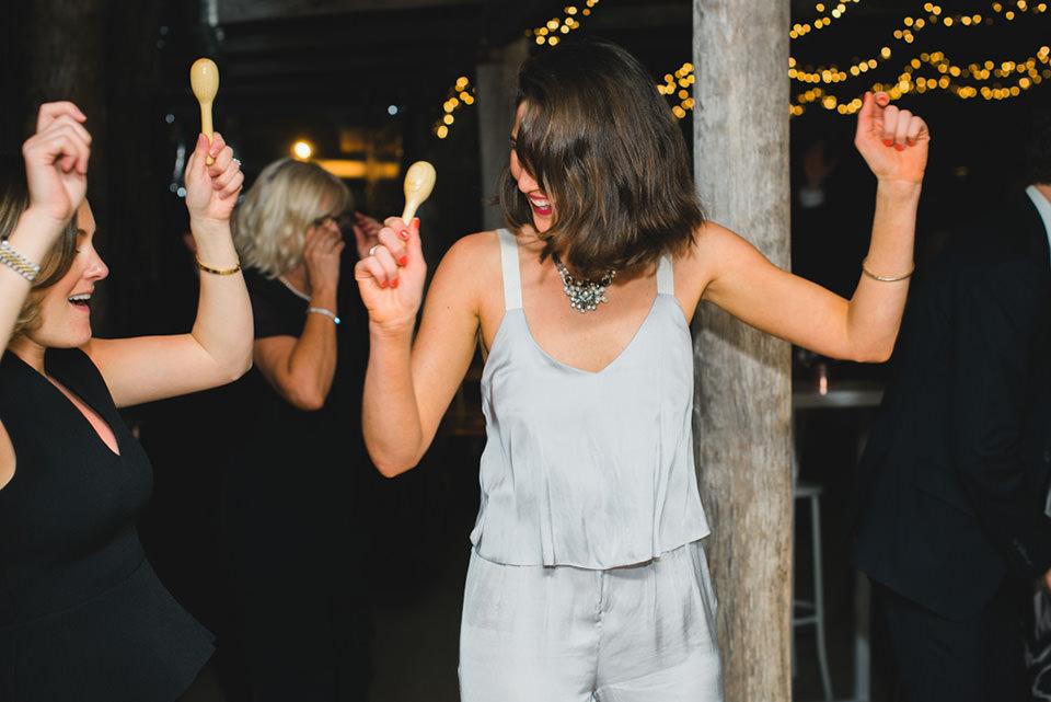 wedding guests dancing at the barn wedding reception