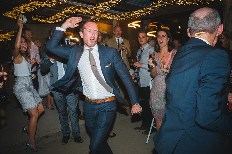 photo of a groomsmen dancing