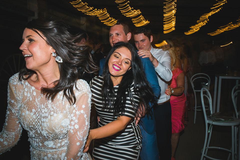 bride dancing in a congo line
