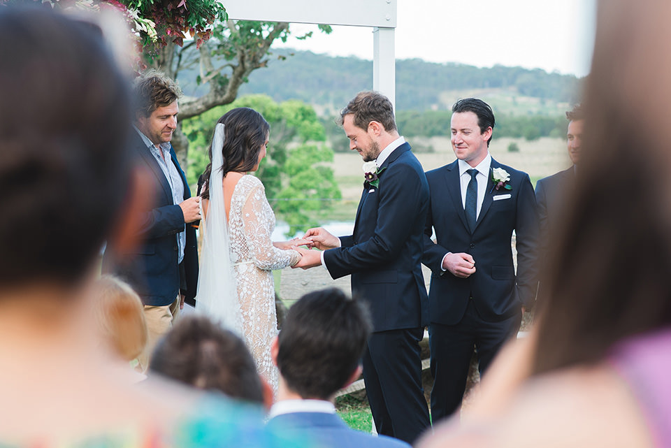 Paul putting the ring on Kate's finger.