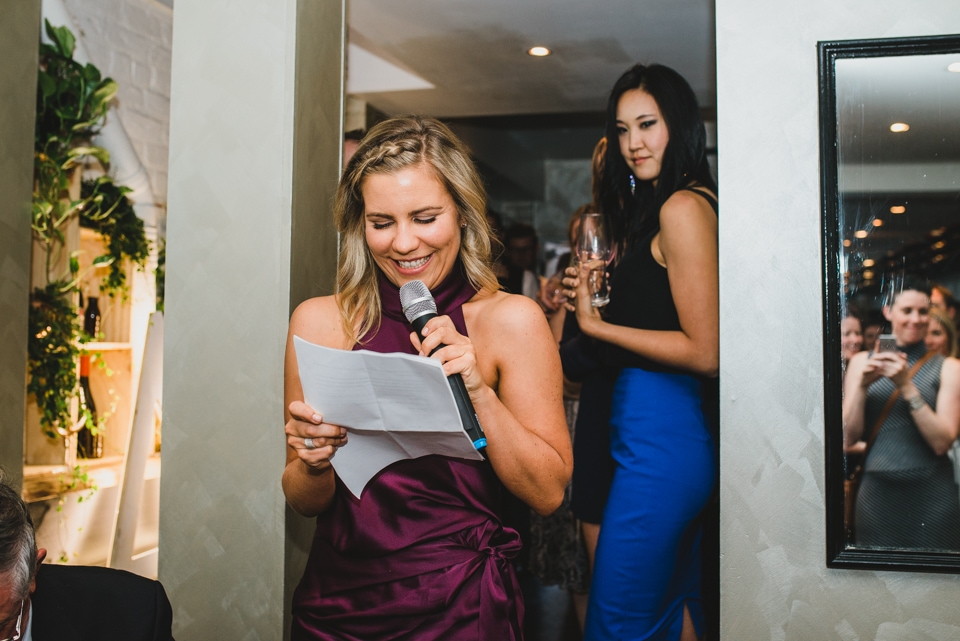 The maid of honour giving her speech during the wedding reception.