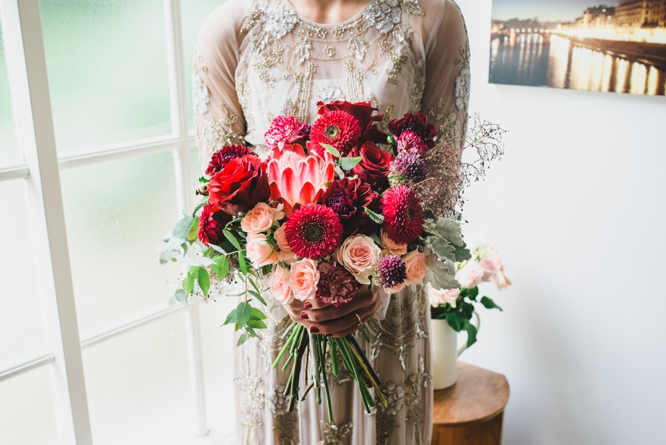 A photo of the Bride holding her wedding flower bouquet.
