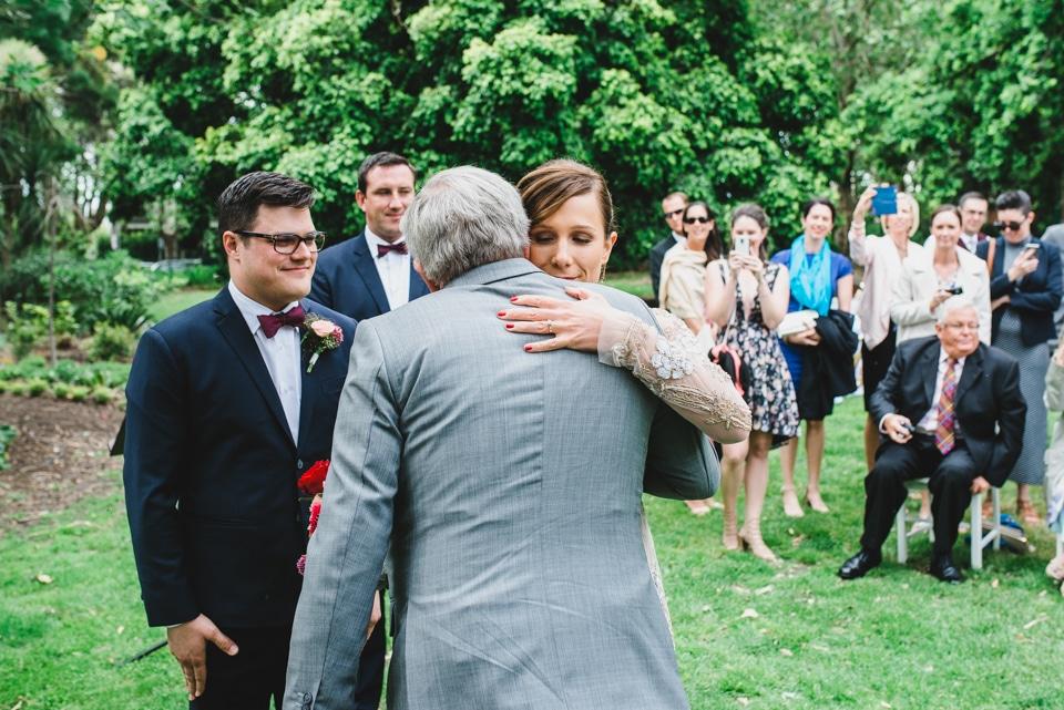 Bride hugging her dad.