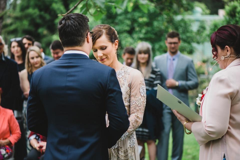 Bride and groom laughing during the wedding. Victoria Gardens prahran wedding ceremony.