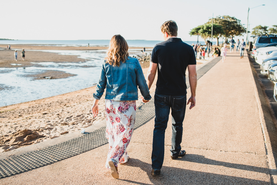Alex and Sam walking along Wellington Point, Brisbane, for their engagement shoot with Lionheart Photography.