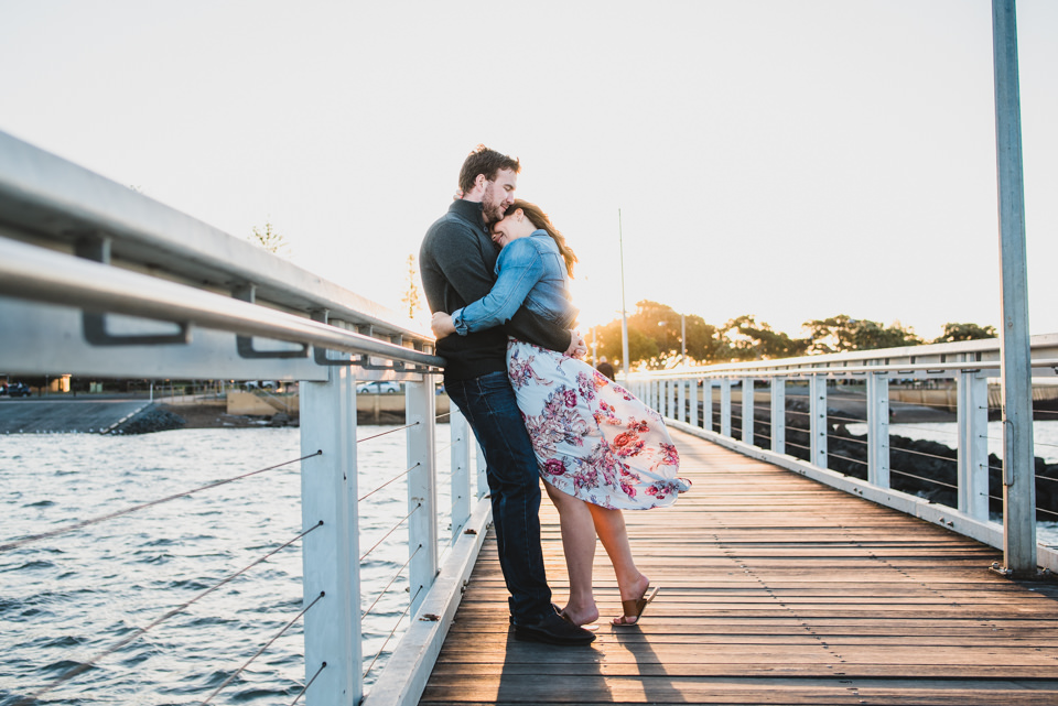 Alex & Sam cuddling on the jetty. Engagement Shoot Wellington Point, Brisbane.