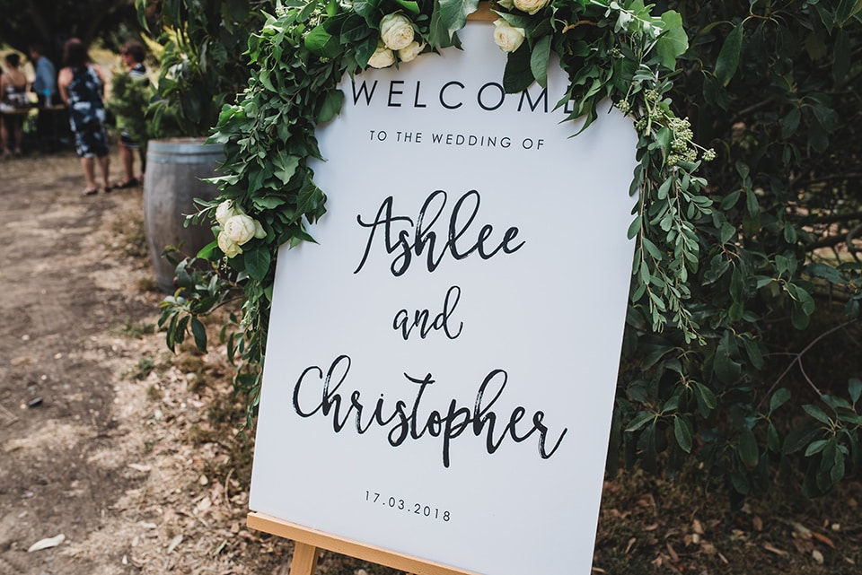 Beautiful welcome sign for Ashlee & Chris' wedding ceremony.