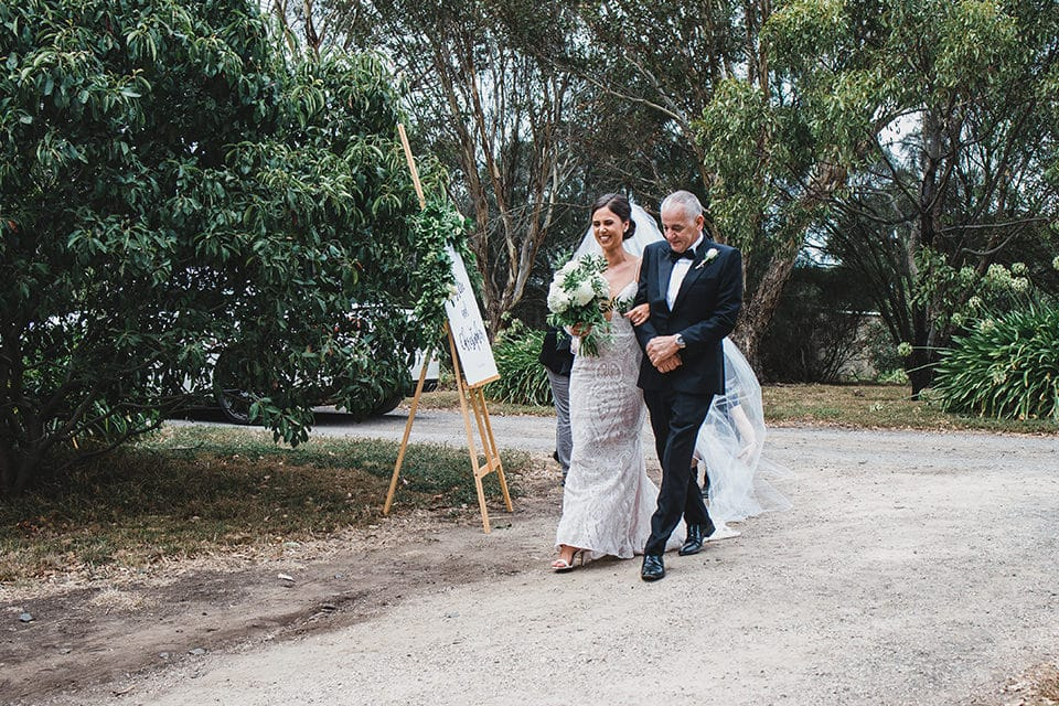 The bride walking down the isle at her Terindah Estate wedding.