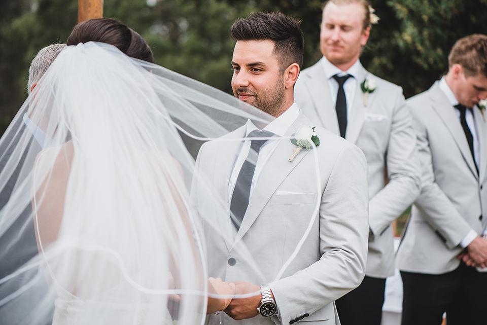 The groom, Chris, looking at his bride, Ashlee.
