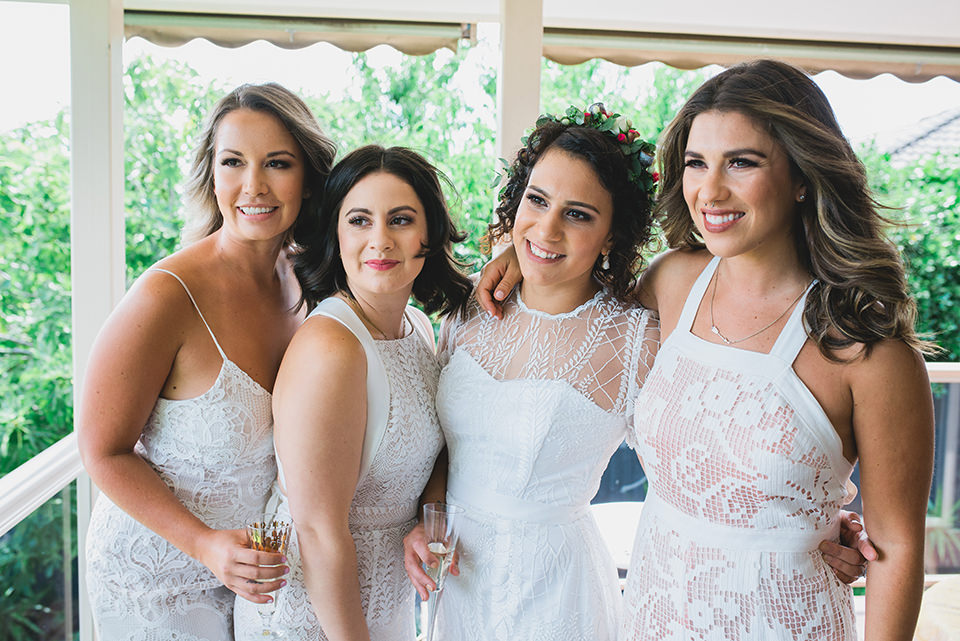 Bride and Bridesmaids having fun while getting ready for the wedding.
