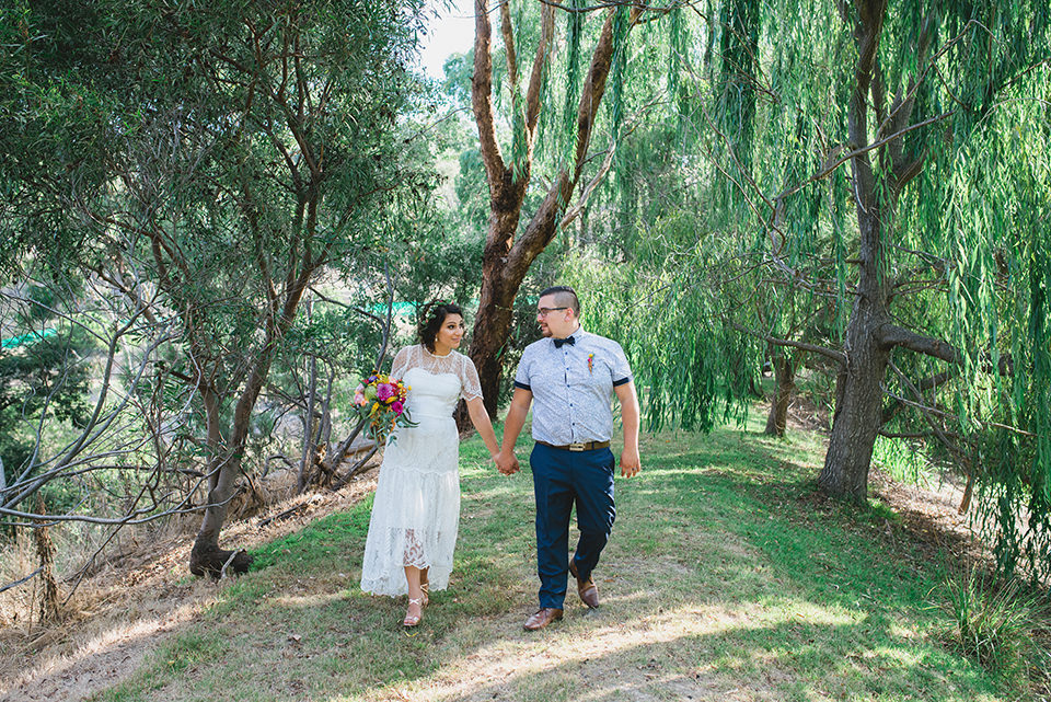 Daniel and Carla walking during their Inglewood Estate wedding photos by Lionheart Photography.