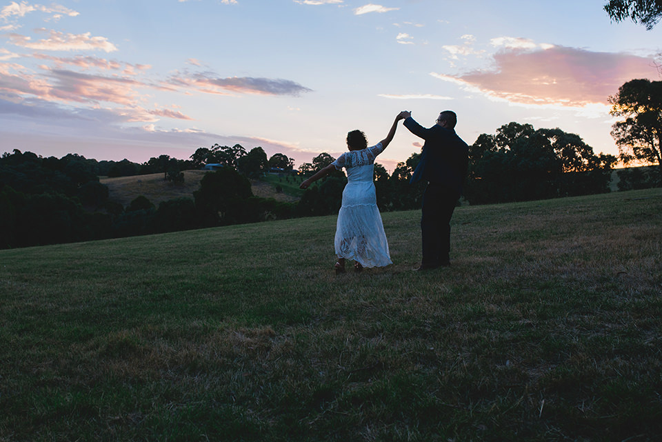 Sunset photos of Carla & Daniel dancing on the hill.