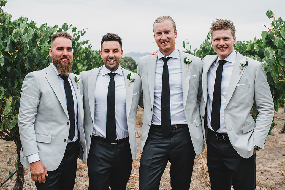 Bridal party portraits taken in the vineyard.