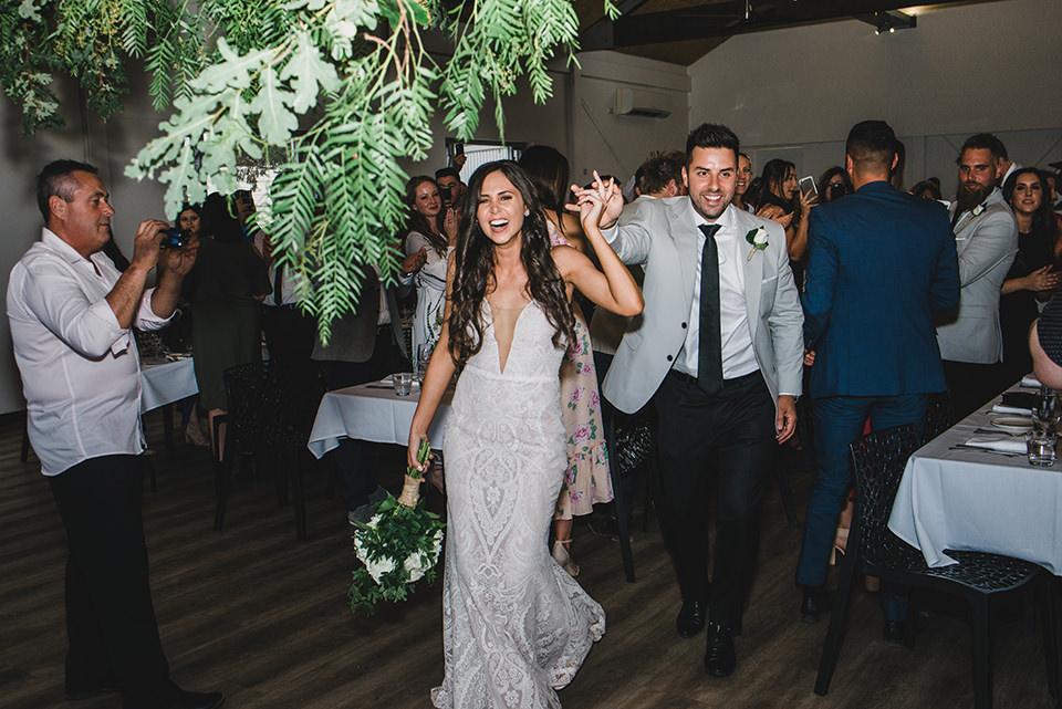 Bride and Groom entering into the wedding reception room.