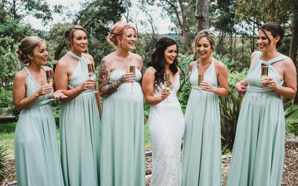 The bride and her bridesmaids having a glass of champagne.