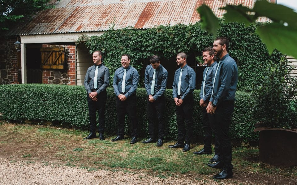 Groom and groomsmen waiting for the bride.