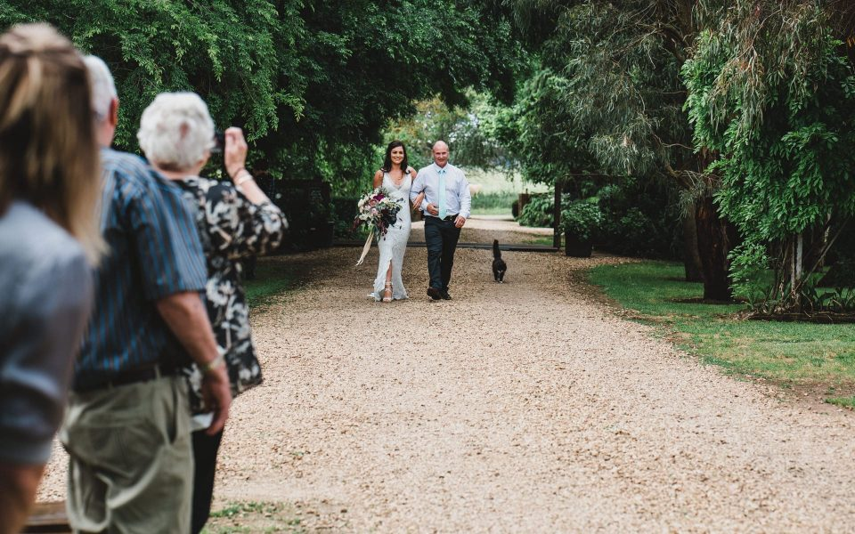 Dad walking down the isle with the bride at Quirindi Stables wedding.