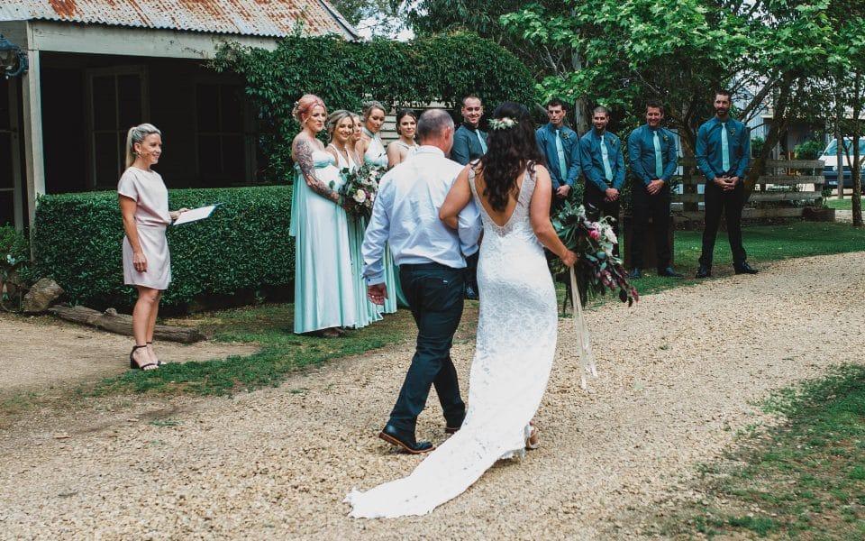 The bride walking down the isle.