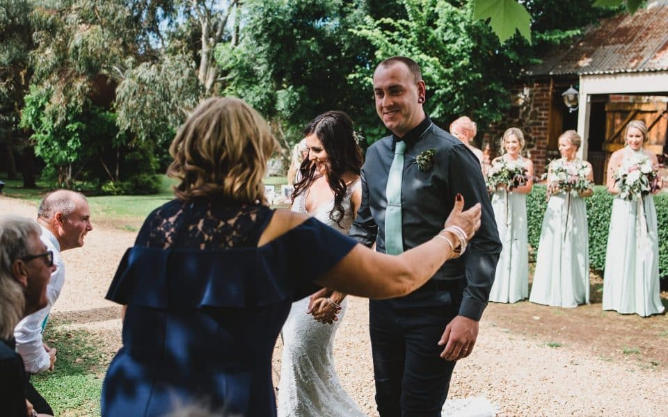 Bride and Groom hugging their guests