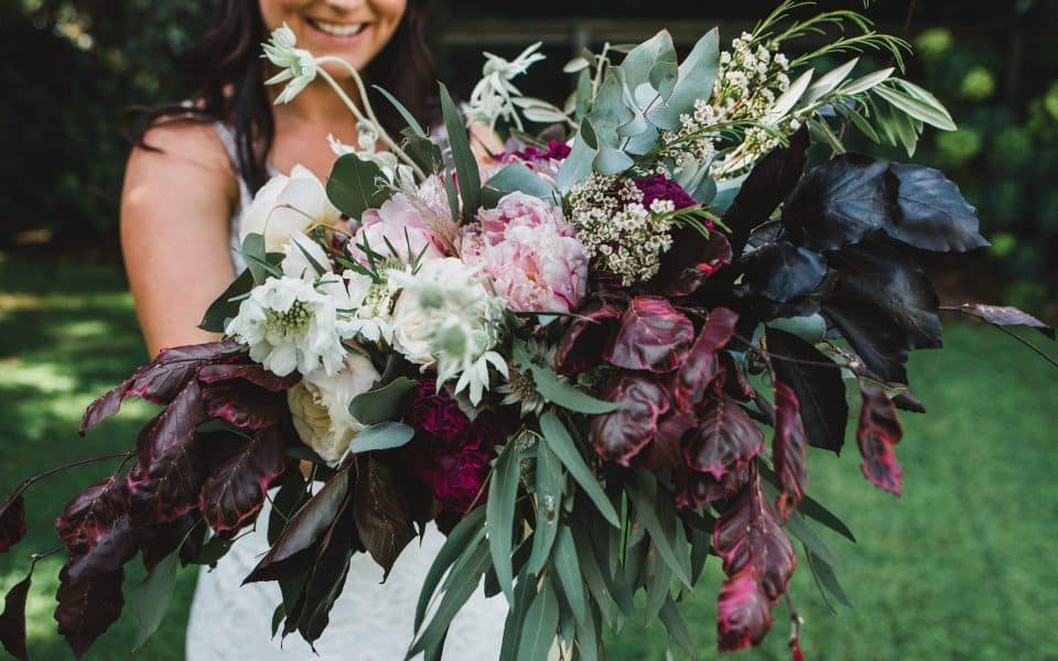 Cara's bouquet was made by Wootton Nicholls, wedding flowers.