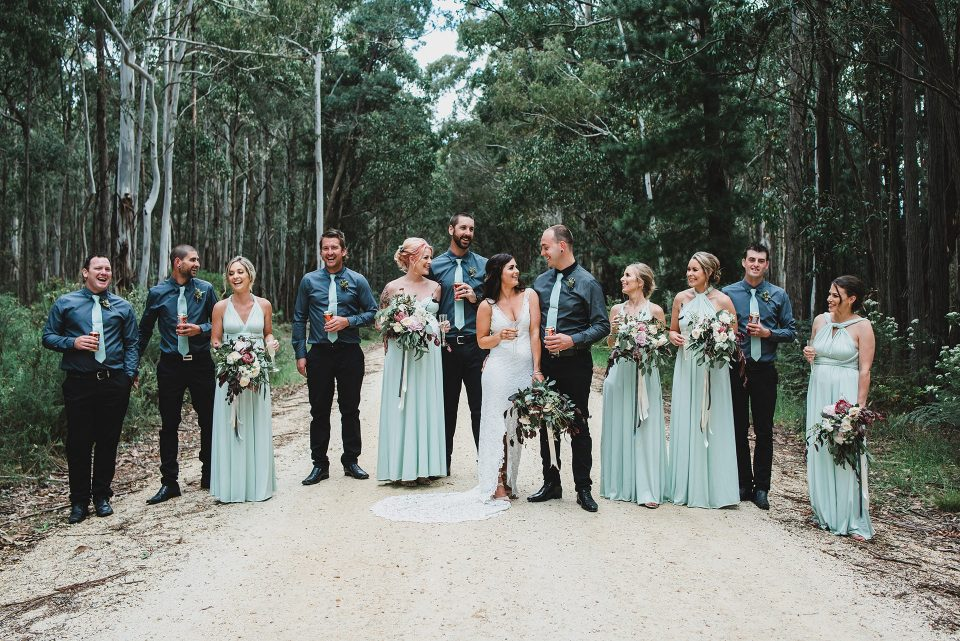 Relaxed and fun photo of the full bridal party at the Quirindi Stables wedding.