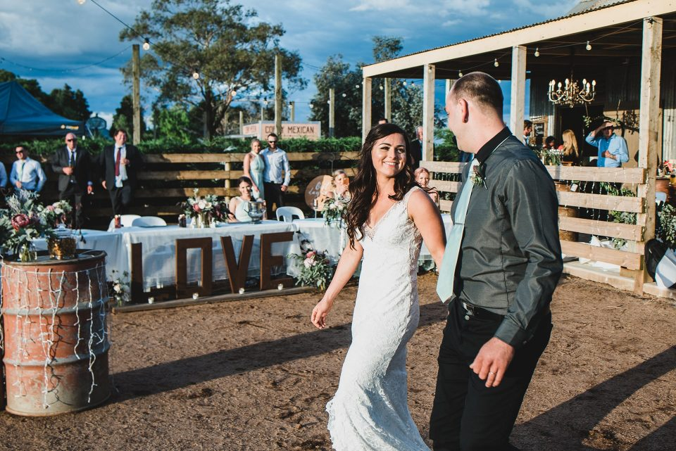 Bride and groom entering the wedding reception held at Quirindi Stables.