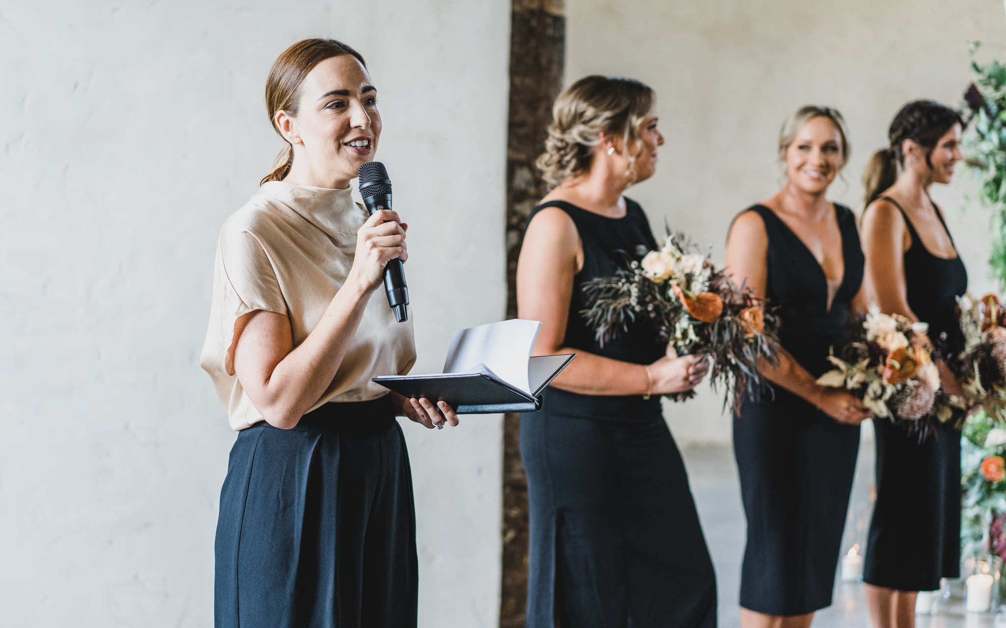 The celebrant, Natalie Drum, talking to the wedding guests