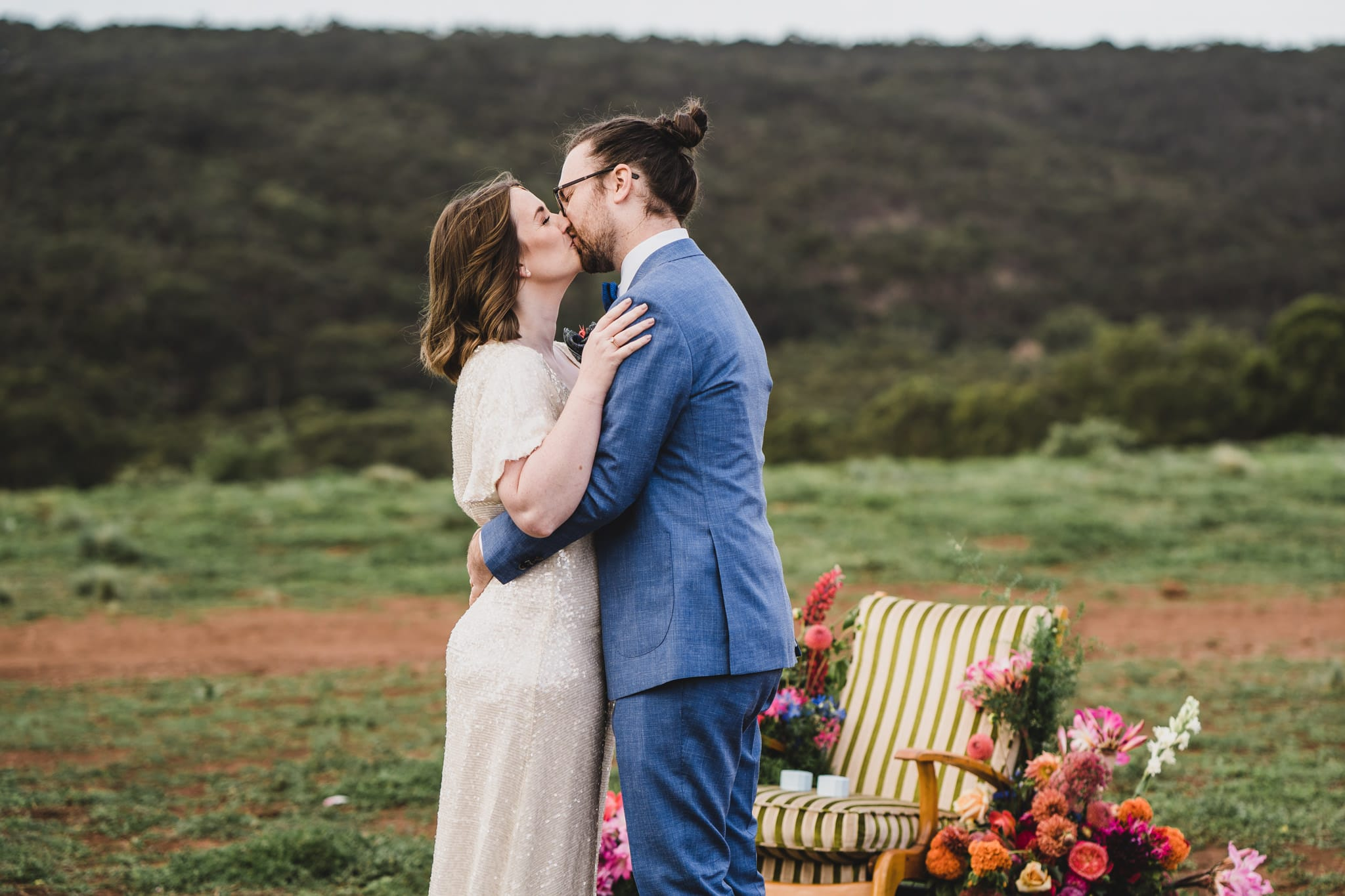 Kate & Brodie's first kiss at their Camp Sunnystones wedding festival