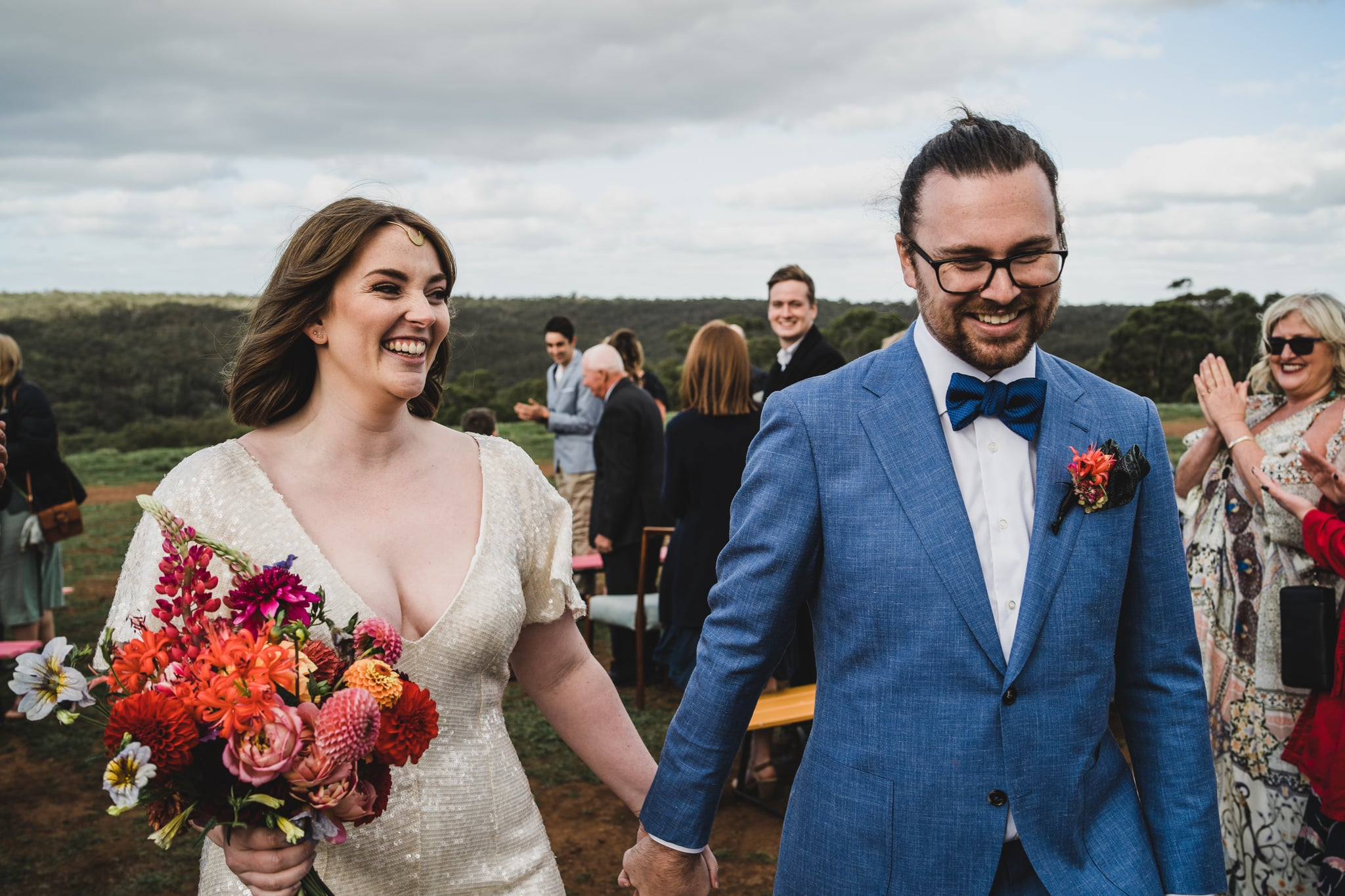 Kate & Brodie walking down the aisle at their Camp Sunnystones wedding festival