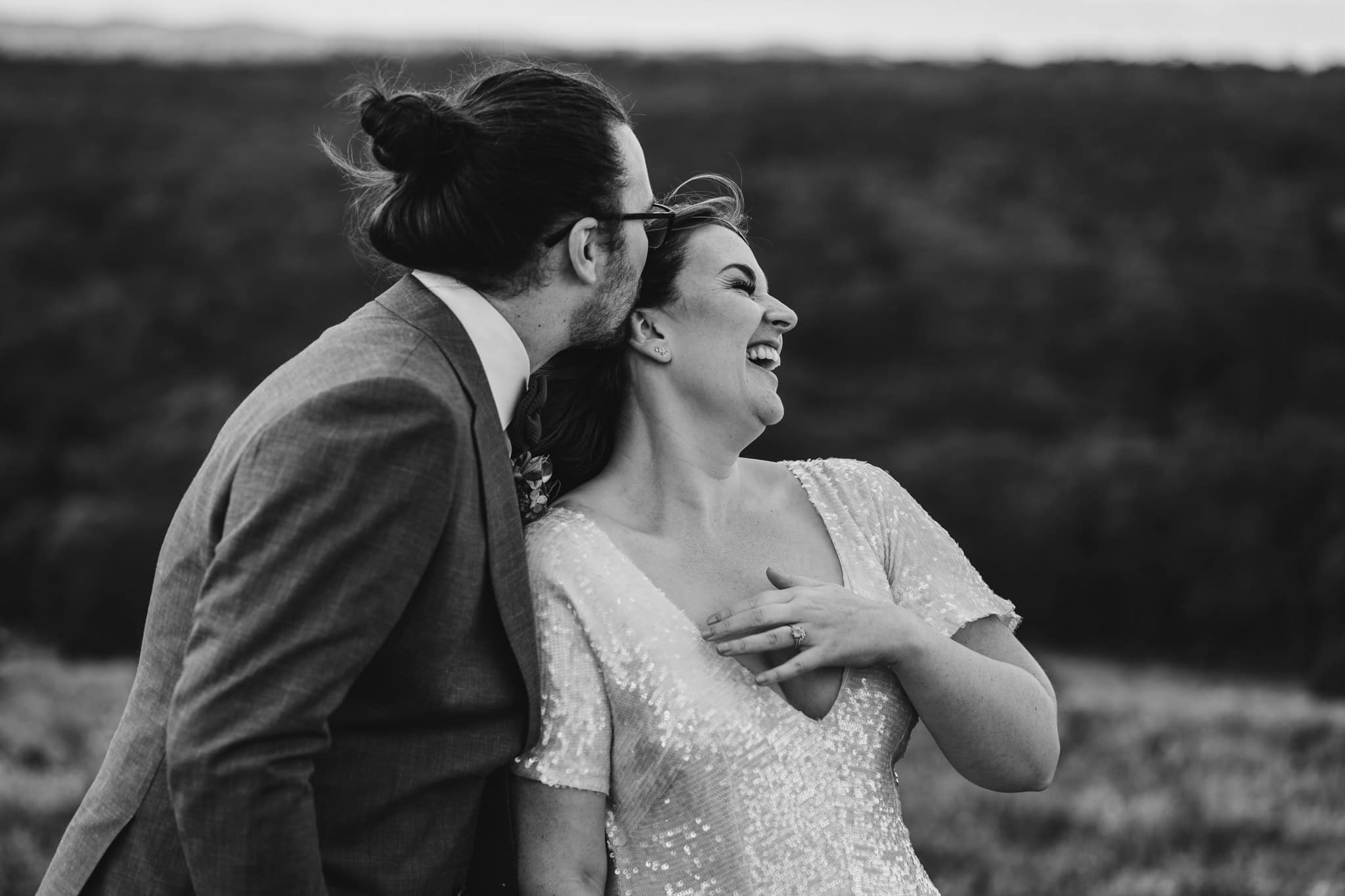 Kate & Brodie laughing during their Camp Sunnystones wedding.