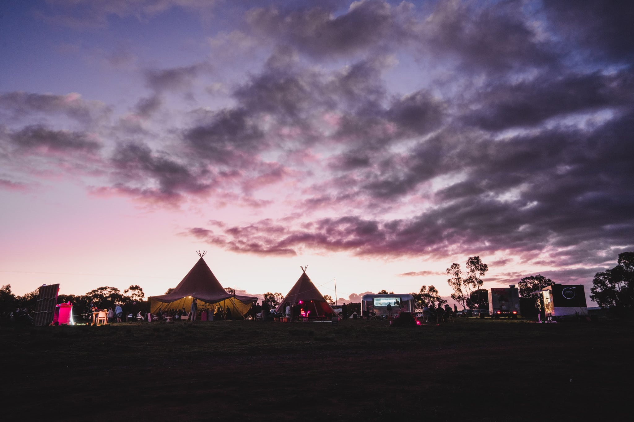 Photo of the Tipis and Food trucks during sunset at Camp Sunnystones during Kate and Brodie's wedding.